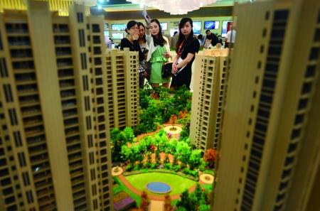 黄其森:资金趋紧 地产并购机会增多