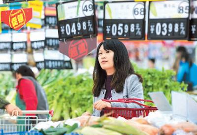 """人民日报海外版:""""中国经济滞胀说""""该收场了"""