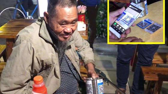英媒:中国手机支付忒疯狂 乞讨者也带二维码