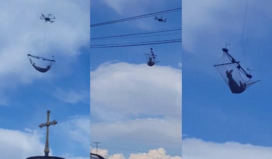 格鲁吉亚空中惊现一男子躺在无人机悬挂吊床里