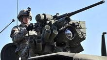 俄潜艇监视美韩军演被逼出水面