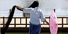 女子29年不剪发留3米长