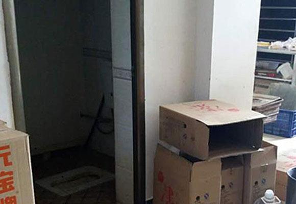 黑面包坊藏身出租屋内 原料堆厕所外