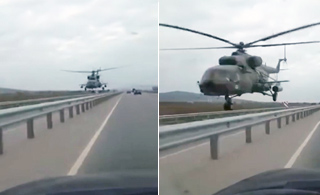 """军用直升机贴着高速低飞 与汽车""""擦肩而过"""""""