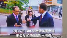 BBC记者现场直播遭美女抢镜 伸手袭胸将其推开