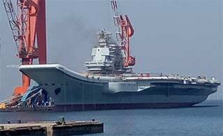 国产航母烟囱冒出黑烟或测试动力