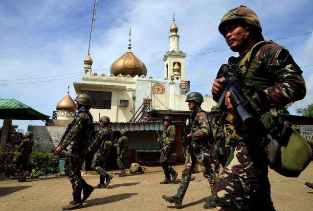 菲律宾军警与武装分子激战 双方超80人丧生
