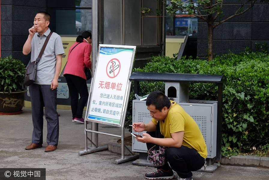 世界无烟日:摄影师镜头下的中国烟民