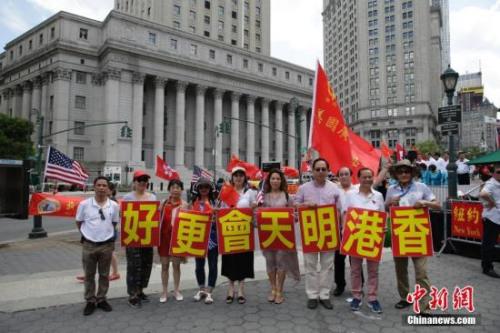 美媒:美东华侨见证香港回归20年 在继续繁荣发展