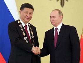 普京向习近平授予俄罗斯国家最高勋章