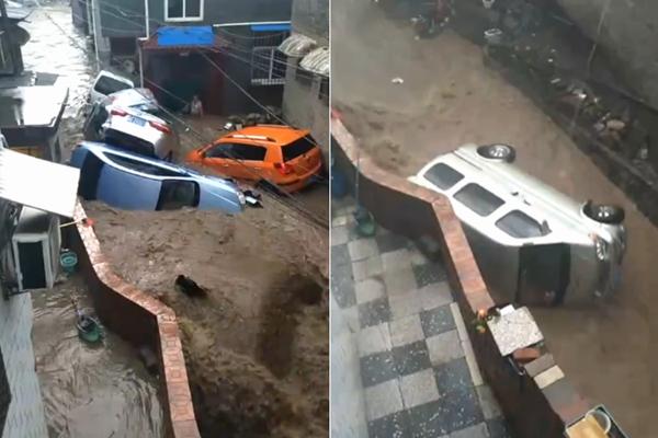 山西暴雨引发山洪 汽车被冲得满街跑