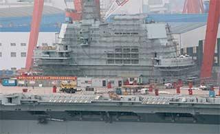 国产航母新进展:脚手架包围舰岛