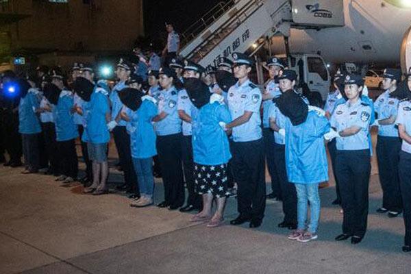 32名电信诈骗嫌犯从柬埔寨被押解回国