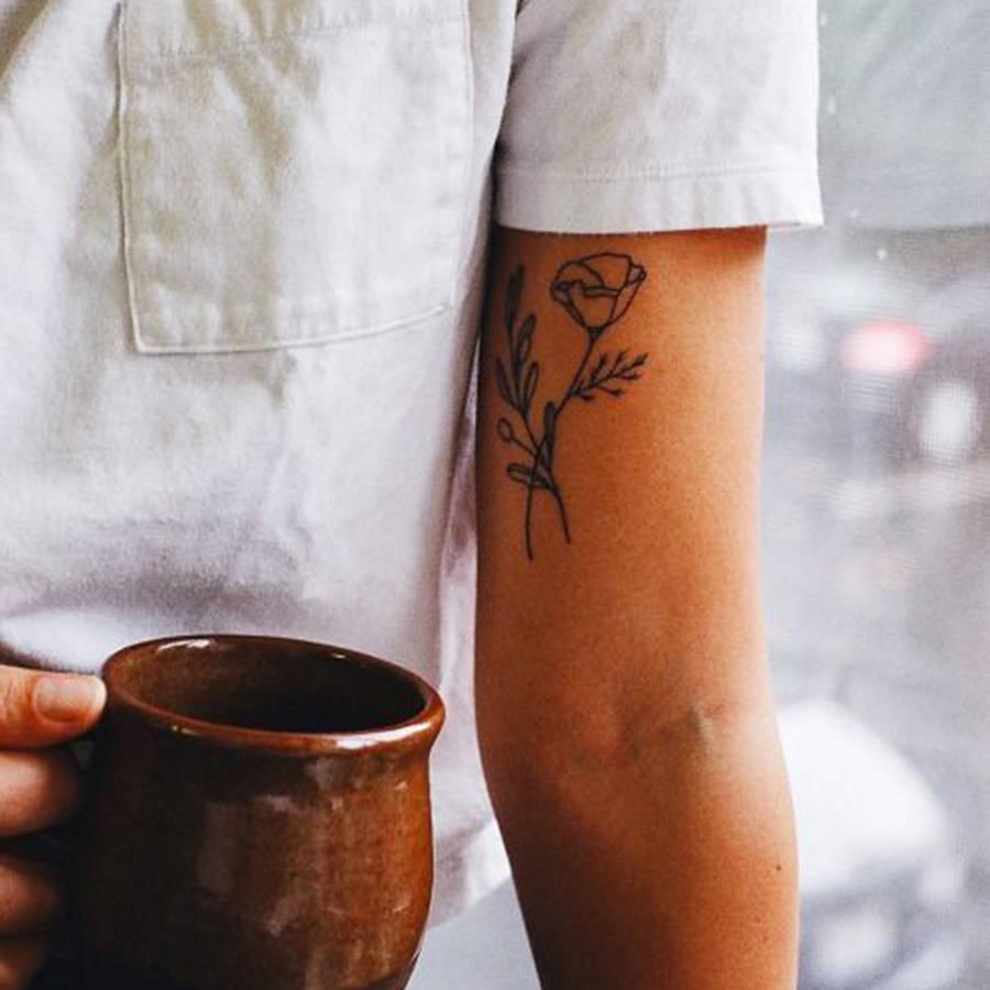 玫瑰化作诗 法媒推荐让您与众不同的玫瑰纹身