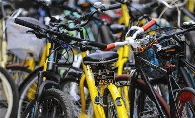 """外媒:共享单车""""野蛮生长"""" 中国多地限制投放"""