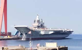 新进展:国产航母舰艏冲洗锚链