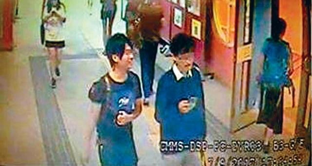 香港冷血标语肇事者被曝光:两男子犯案后边走边笑
