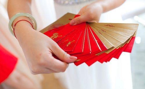 """美媒:当在美华人遭遇""""红包礼节"""" 该如何随份子"""