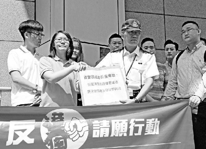 """专访香港青年学界反""""港独""""召集人:香港学生和内地学生一条心"""