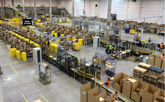 亚马逊仓库迎机器人大军 没被裁的员工去哪了?