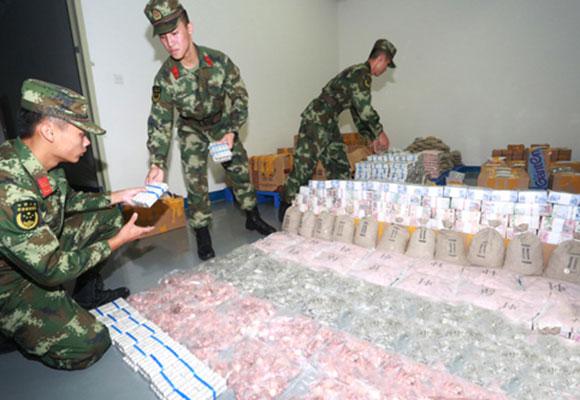 广东警方查获近4吨走私外币 涉38个国家