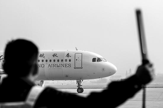 春秋航空回应同航班中日版本燃油费差价:汇率原因
