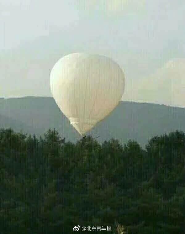 吉林男子乘氢气球摘松籽 气球带男子飘走3天未归