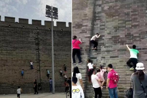 """古城墙成""""攀岩墙"""":孩子攀爬 家长拍照"""