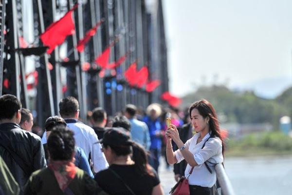 边境游受热捧!欣赏中朝风光成丹东旅游亮点
