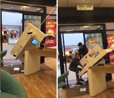 英四名歹徒抢劫手机店 试图拽走整个展示台