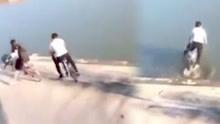 尴尬!男子骑车超车冲进河道