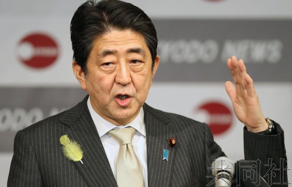 安倍称明年年初讨论修改日本防卫大纲