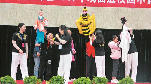 丰都:国家级非物质文化遗产木偶戏走进校园