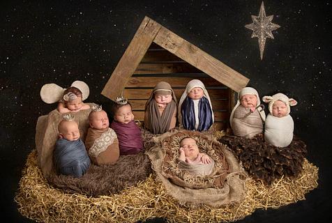 摄影师为新生儿拍照 重演基督诞生场景