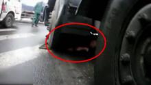 司机被撞卷车底 众人齐施救