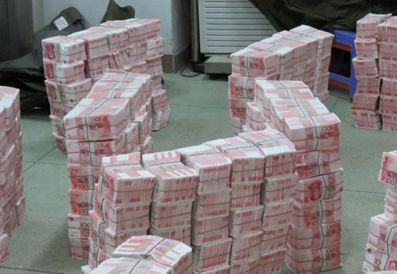 广东侦破特大伪造货币案 缴获假人民币2.14亿元