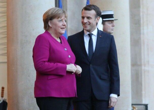 马克龙向默克尔表支持 强调推动欧洲改革需要德国