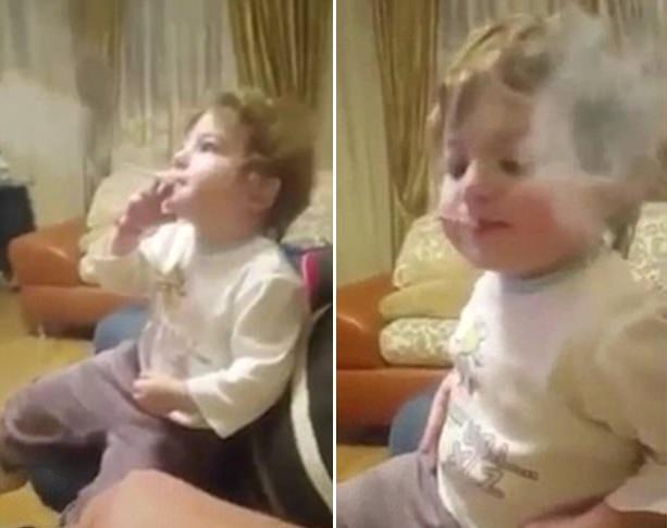 俄2岁幼童熟练吸烟视频引网友愤怒 斥其父母失职