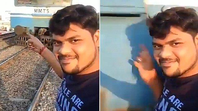 印男子在铁轨旁自拍被火车撞飞侥幸生还