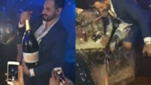 男子开昂贵香槟手滑摔碎 27万瞬间变成地上泡沫
