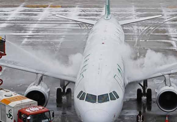 大雪过后 上海两大机场逐步恢复正常运行