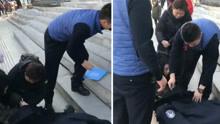 暖!铁岭老太手臂摔骨折躺地 民警脱下棉衣给老人取暖
