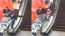 小孩爬电梯险坠落 热心男女一把抱回
