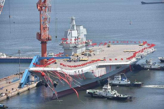 揭秘:首艘国产航母在哪些方面超越了辽宁舰?