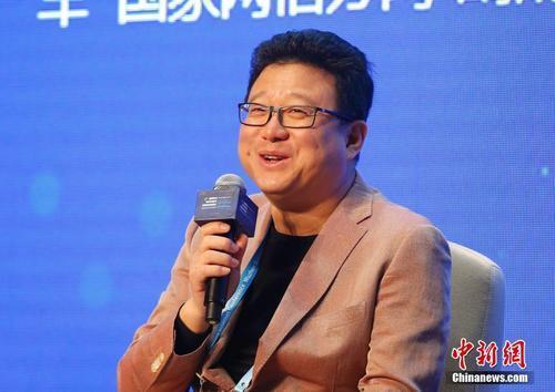 丁磊:推动个税逐步转向综合计征 降低综合税率
