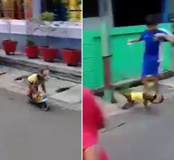 印尼街头猴戏表演出意外 小猴骑摩托撞倒儿童