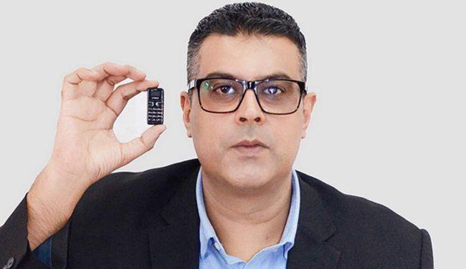 世界最袖珍手机只比硬币稍大 键盘屏幕五脏俱全