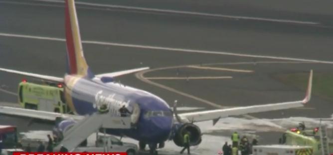 美国一客机飞行途中引擎爆炸致1死7伤 女子几乎被吸出舱
