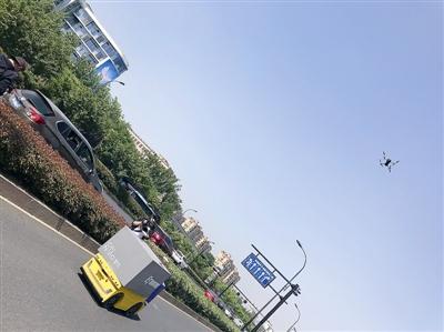 用无人机围观无人车路测 也许年内它会给杭州人送快递