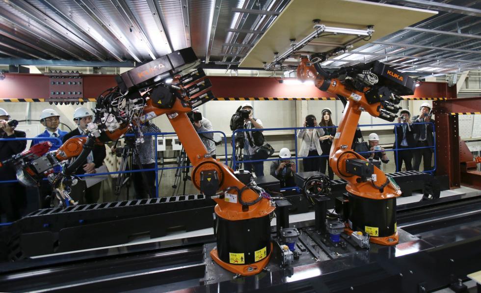 劳动力短缺 日本建筑商想用机器人参与盖楼